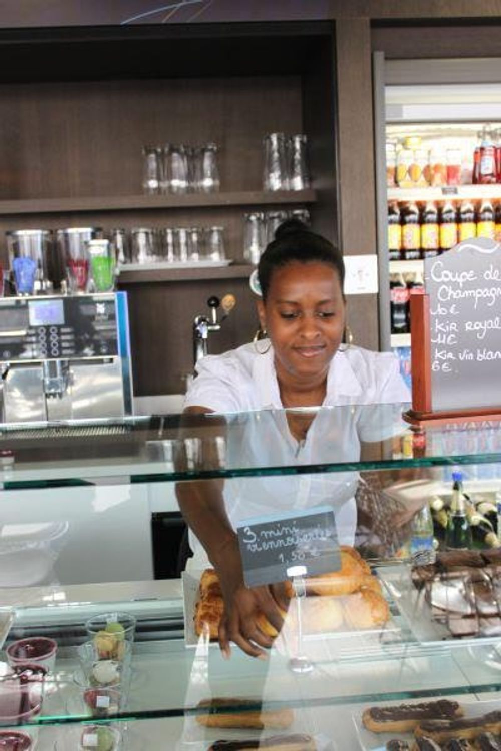 Lady Serving Patisserie and Goodies Behind the Counter of 360 Café