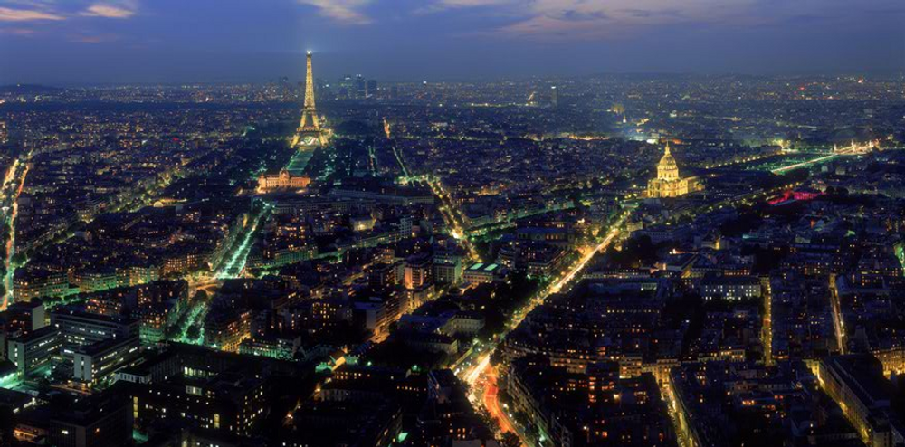 title: Paris Lights of the Tour Eiffel and Les Invalides at Night from the Terrace of Montparnasse Tower