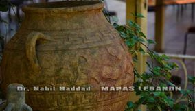 title: Pot Outside the Restaurant of Grotto