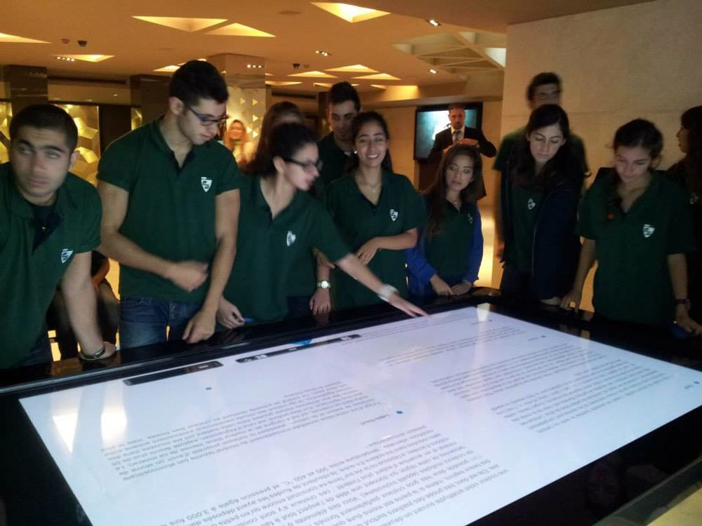 title: Students Gathered Around Multitouch Table