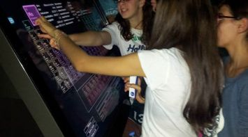 title: Students Gathered Around the Mendeleev Table App on the Multitouch Table by Paravision