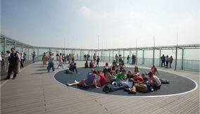 Students in a Circle Sitting on the Floor of Montparnasse Tower s Open Air Terrace