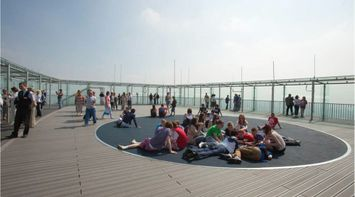 title: Students in a Circle Sitting on the Floor of Montparnasse Tower s Open Air Terrace