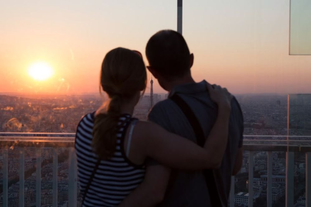 Sweet Couple Watching the Sunset over Paris