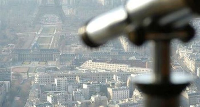 title: Telescope Pointing Toward the Eiffel Tower from Tour Montparnasse 56 Terrace