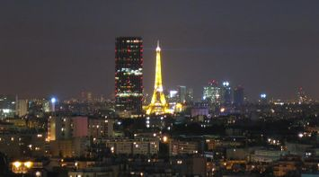 title: The Yellow Lit Up Tour Eiffel of Paris