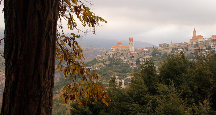title: A View of Bsharri and its Cathedral Landmark from the Forest