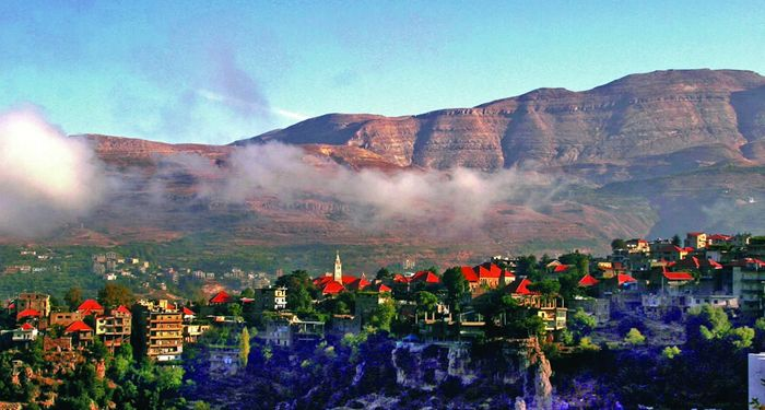 title: Beautiful Stunning Nature Mountains and Low Clouds of the Town of Bsharri in Tripoli