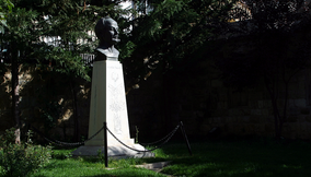 title: Head Bust Statue Monument in the Garden