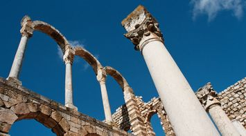 title: Tall Stone Columns in the Umayyad Palace Ruins