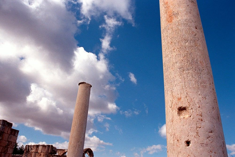 White Clouds Passing Over Inscribed Stone Columns of the Abandoned City Palace