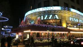 title: Video of a Crowded Pizzeria Restaurant at Night on Avenue des Champs Elysees