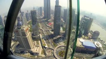 title: Aerial view of Shanghai from the top of the Oriental Pearl Tower