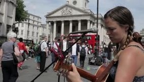 British Artist singing in front of the National Gallery London
